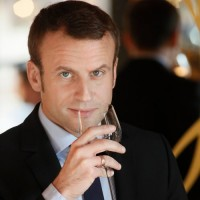 French President-elect Emmanuel Macron noses a glass in a Terre de Vins video.