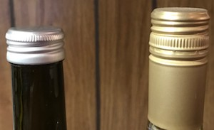 Standard Stelvin screw cap on the right. Short screw cap on the left.